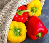 picture of yellow-pepper  - red and yellow pepper on burlap sack on wooden - JPG