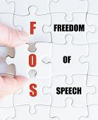 foto of freedom speech  - Hand of a business man completing the puzzle with the last missing piece - JPG