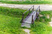 foto of old bridge  - Small old wooden bridge over the stream - JPG