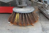 pic of sweeper  - Brush of Sweeper Truck cleaning on the street  - JPG