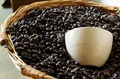 stock photo of coffee coffee plant  - roasted coffee beans in brown basket soft focus focus on coffee - JPG