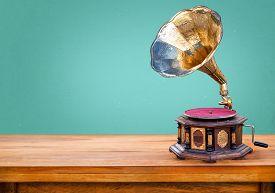 foto of mint-green  - Old gramophone retro radio receiver vintage green background - JPG