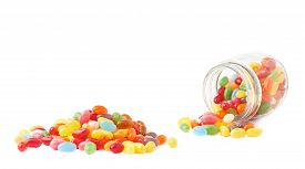 picture of jar jelly  - Composition of a glass jar and multiple colorful jelly bean candies - JPG