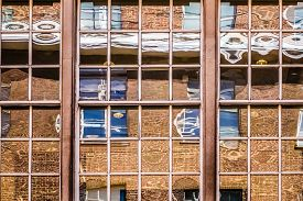 foto of distort  - Distorted reflection in the windows of an office building - JPG
