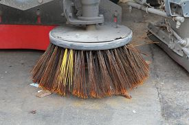 stock photo of sweeper  - Brush of Sweeper Truck cleaning on the street  - JPG