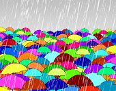 Editable vector illustration of umbrellas in rain