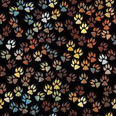 Editable vector seamless tile of colorful dog paw prints