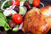 Roast chicken and Greek salad, with cos lettuce, red onion, black olives, grape tomatoes, fetta chee