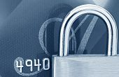 Business security: brass padlock on credit card.  Macro view, in blue tone.