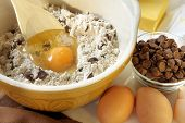 Baking chocolate chip cookies.  Mixing bowl with flour, eggs, chocolate chips and butter.