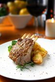 Rack of lamb with seeded mustard, rosemary and roasted potatoes.