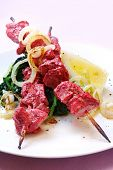 Tandoori chicken with a modern flavour - skewers served with wilted spinach and sauteed onions.
