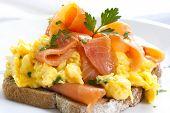 Scrambled eggs with smoked salmon, on sourdough toast.