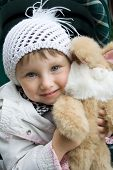 Small Smiling Girl With Plush Toy. poster