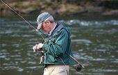 Fixing His Fishing Line