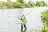 picture of fisherwomen  - woman fishing in pond in spring country - JPG
