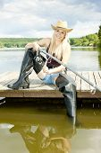image of fisherwomen  - fishing woman sitting on pier in summer country - JPG