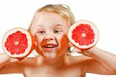 Little boy with a pink grapefruit