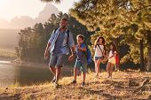Children Walk By Lake With Parents On Family Hiking Adventure poster