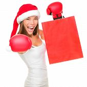 image of boxing day  - Boxing day shopping woman in Santa hat holding shopping bag with copy space - JPG