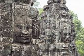 Stone Face Smile Of Ancient Buddhist Temple Bayon In Angkor Wat Complex, Cambodia. Ancient Architect poster