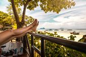 Female Tourist Chilling In Front Of Bungalow On Chair Close To The Beach Of Thailand poster