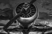 Vintage Warplane In Black And White Photo And A Cloudy Sky Background poster