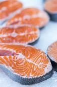 Lots Of Fresh Raw Salmon Steaks On Ice In Supermarket. Fresh Raw Salmon On Ice. Big Pieces Raw Salmo poster