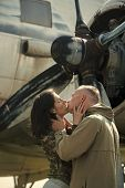 Passionate Couple Kissing, Boy And Girl. Couple Kissing In Front Of Propeller Of Old Plane On Sunny  poster