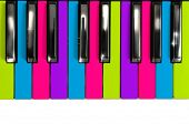 foto of rainbow piano  - Creative multicolored piano keys in a disco style - JPG