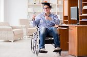 Disabled student studying at home on wheelchair poster