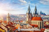 High spires towers of Tyn church in Prague city (Church of Our Lady before Tyn cathedral) urban land poster