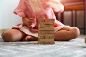 Children Building Wood Blocks At Playground. Girl Kid Playing Stacking Wood Blocks For Meditation Pr poster
