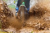 Enduro Rides Through The Mud With Big Splash,driver Splashing Mud On Wet And Muddy Terrain,motocross poster
