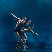Young Couple Of Ballet Dancers Dancing Under Water Splash And Drops. Young Caucasian And Afro Americ poster