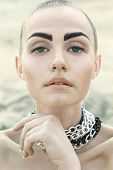 Fashion Portrait Of Beautiful Woman With Chained Neck