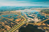 Belarus. Aerial View Of Road Through Ponds In Autumn Landscape. Ponds Of Fisheries In The South Of B poster