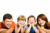 stock photo of family fun  - Portrait of happy family members looking at camera with smiles - JPG
