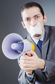 Businessman shouting via loudspeaker