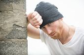 Sexy Ginger Unshaven Brutal Man Wearing Beanie Cap Standing Near The Wall. Man Style And Fashion. Br poster
