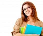 Happy female student holding notebooks - isolated over a white background