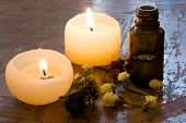 image of essential oil  - Essential oil flower and candles in a tight composition - JPG