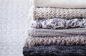 Pile Of Knitted Woolen Sweaters. Monochrome Gradient Shades Grey White Black Colors Clothes With Dif poster