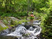 Woman At Small Waterfall 1