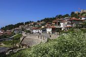 Antique Ancient Roman Amphitheater Or Antique Theatre Of Ohrid With View On Old Town Of Ohrid And La poster
