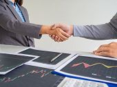 Team Of Stock Trader Discuss Graph Report And Hand Shake Deal On Online Trading Guidelines, Set Targ poster