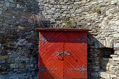 An Old Wooden Cupboard With Forged Elements On The Background Of A Grey Wall Of Kamianets-podilskyi  poster
