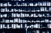 Office Building At Night. Late Night At Work. Glass Curtain Wall Office Building. Office Building Ex poster