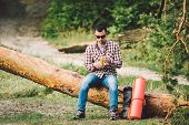 Eating Banana Outdoors Hiking Trail. Theme Hiking And Nature Travel. Tourist Take A Rest And Eating  poster