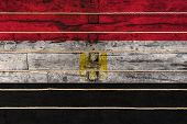 National Flag  Of Egypt On A Wooden Wall Background. The Concept Of National Pride And A Symbol Of T poster